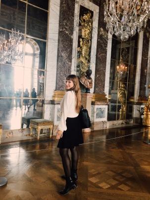 silk blouse, simple black skirt