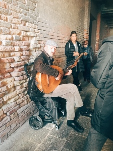 alleyway serenade on an old guitar