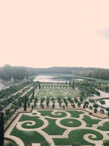 view of the gardens from the terrace above