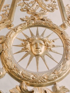the Sun King's many symbols throughout the palace