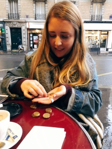 Katie miserly counting her coins