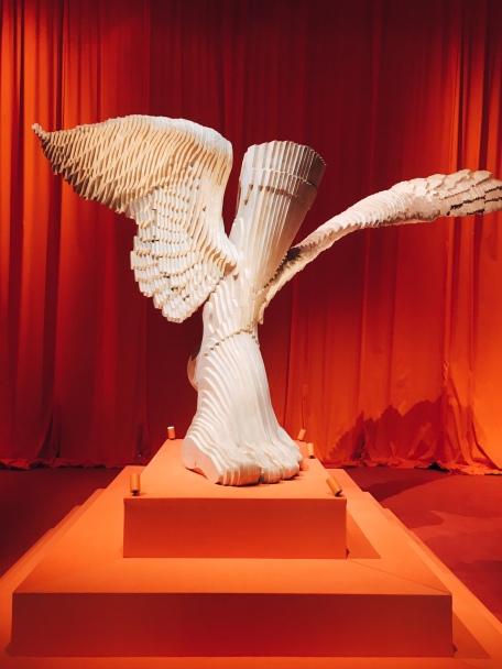 the emblem of the house, Hermès, the winged messenger god